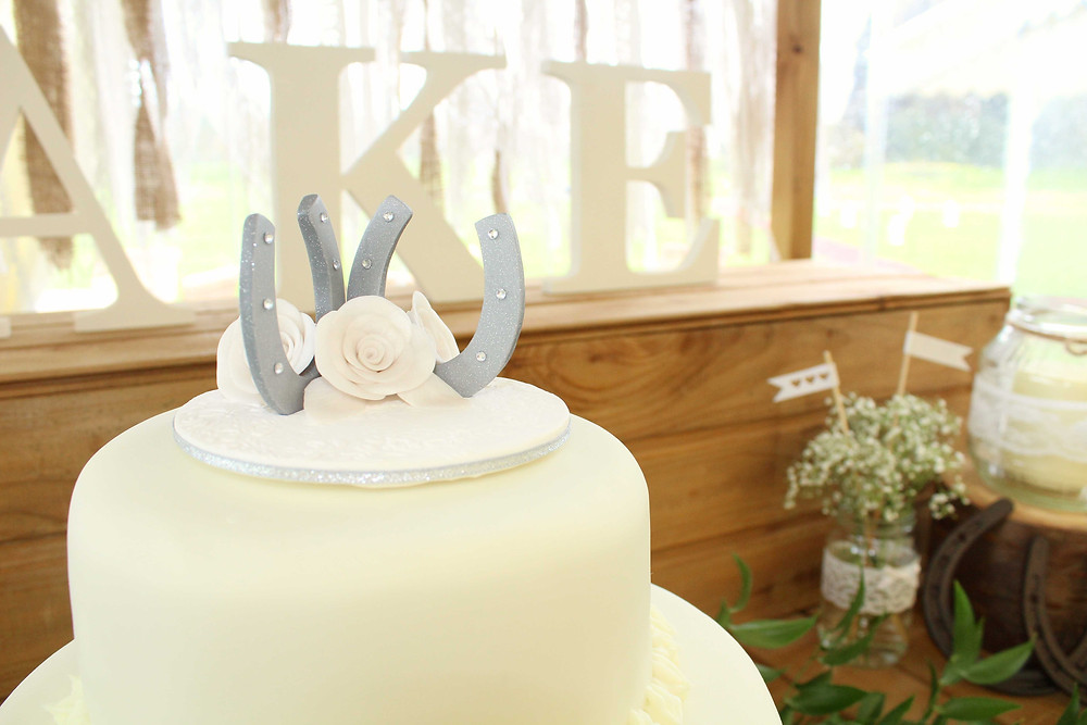 Horseshoe cake topper