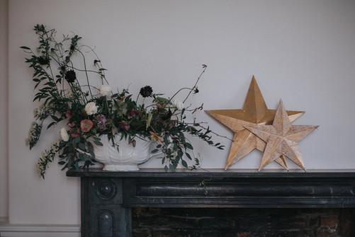 wispy floral arrangement stars wedding purple