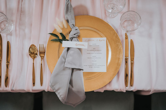 blush pink table cloths, calligraphy place names and menus aith gold cutlery and gold charger plate