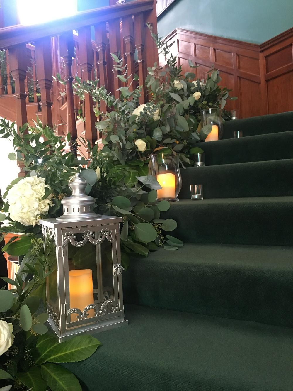 statement floral staircase arrangement