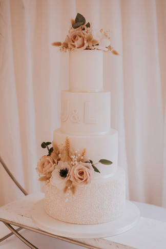 4 tier wedding cake white with dried florals