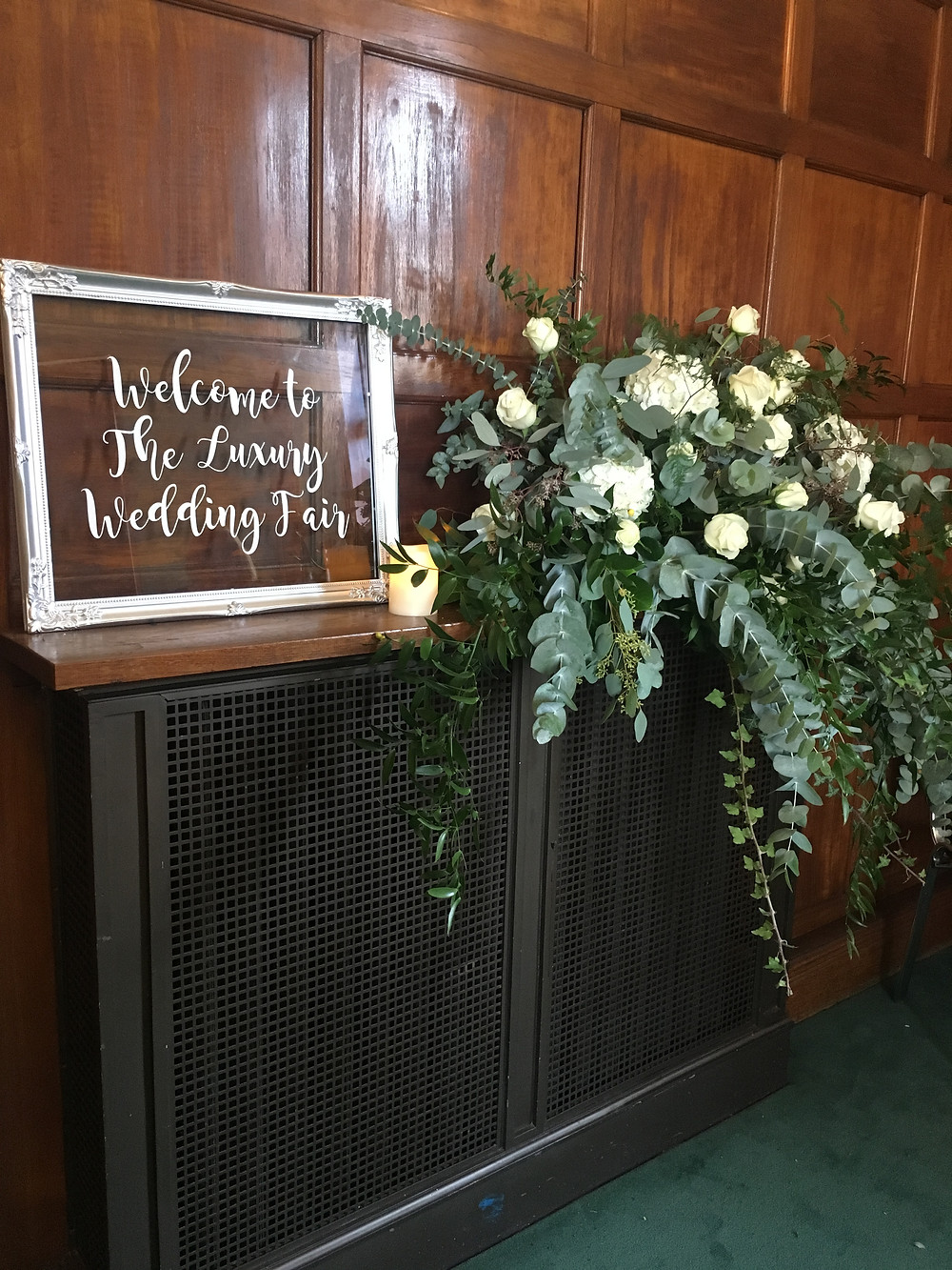 large long and low floral arrangement for wedding eucalyptus and neutrals