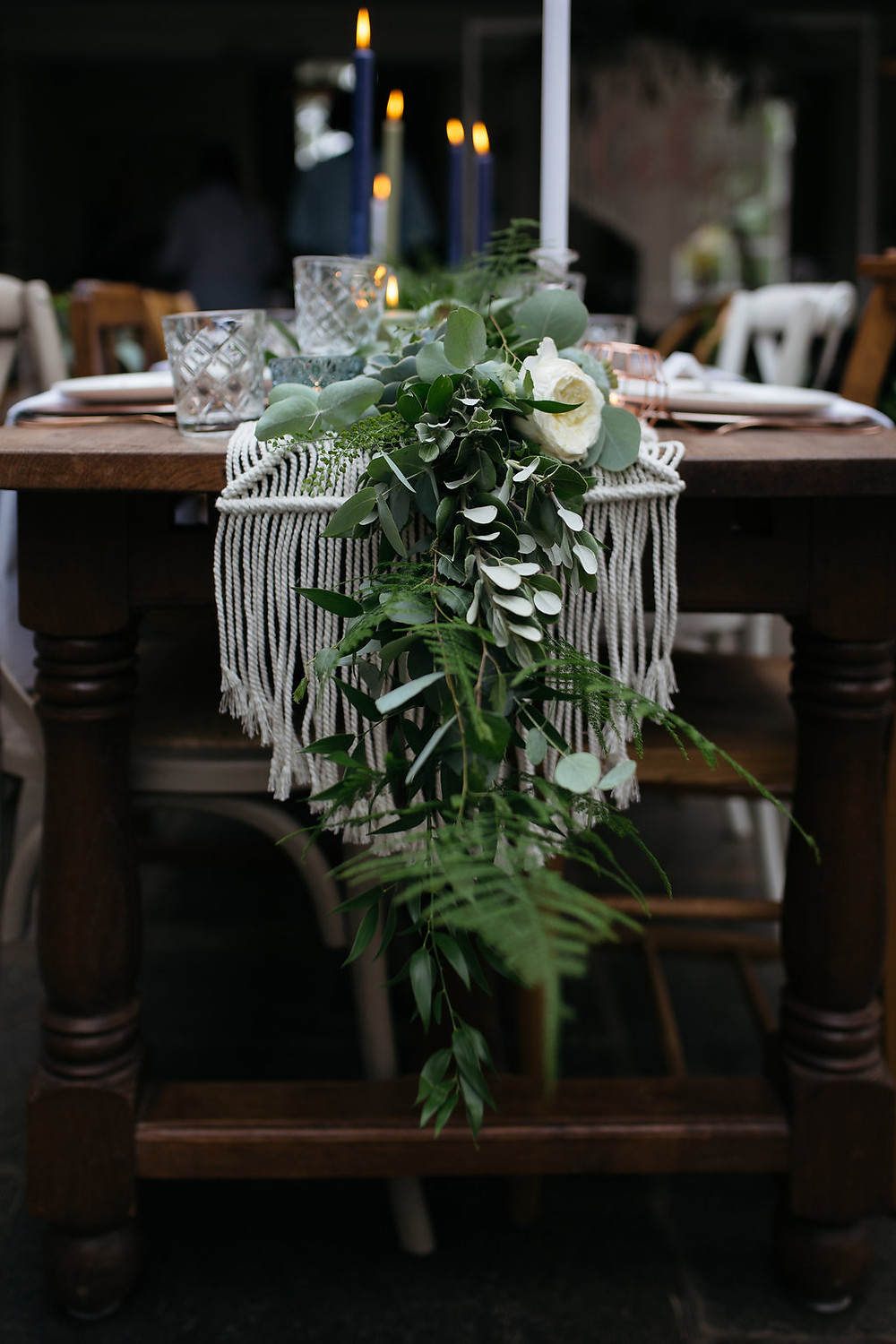 macrame table runner with foliage garland
