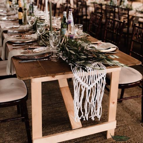 farm barn wedding long trestle tables botanical