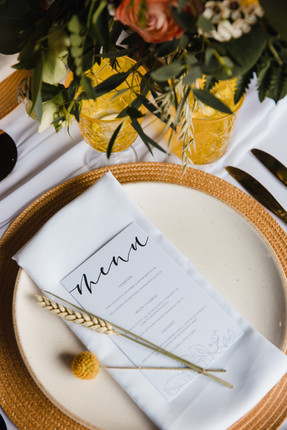 simple white wedding menu with bright colour scheme