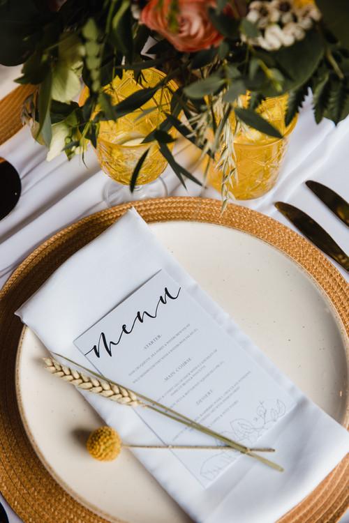 simple white wedding menu with bright colour scheme