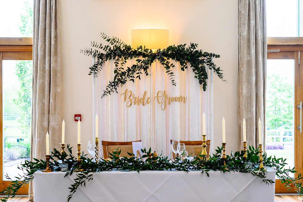 top table goals brass candlesticks and greenery