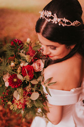 red bridal flowers and off the shoulder dress
