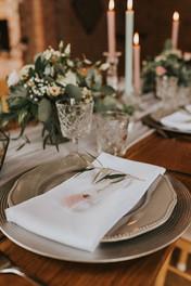 folded wedding napkin & greenery