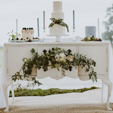 white wedding cake display with flowers