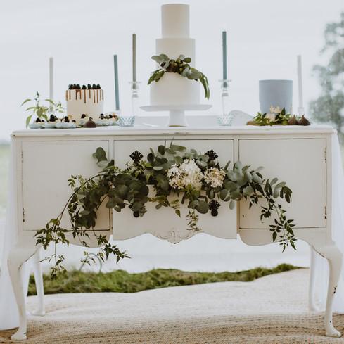 white wedding cake display with flowers