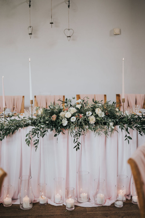 blush pink top table long and low flowers