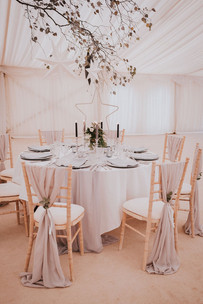 hanging branch above wedding tables
