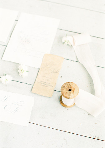 delicate wedding stationery with silk ribbon