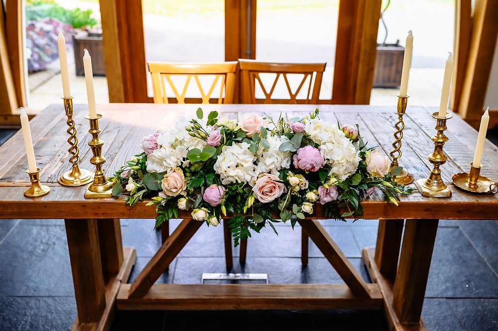 wedding table flowers and brass candlesticks