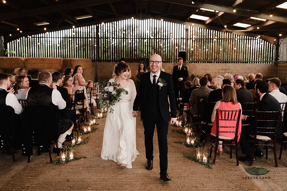 aisle decoration at manor organic farm wedding in a barn