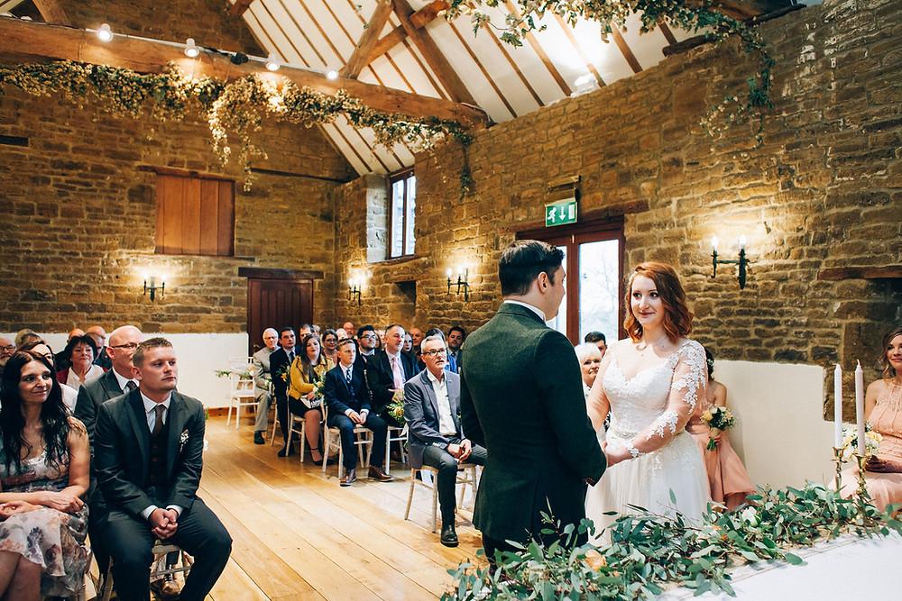 hops in vaulted brick wedding barn