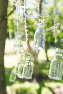 hanging milk bottles from tree