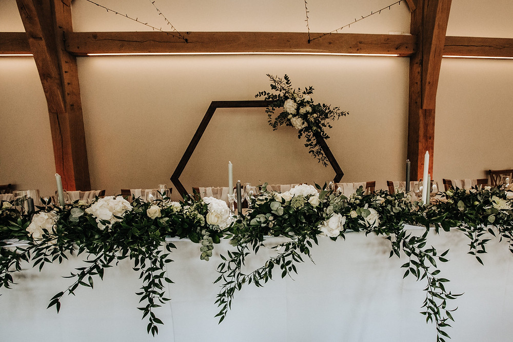 wooden hexagon backdrop top table goals