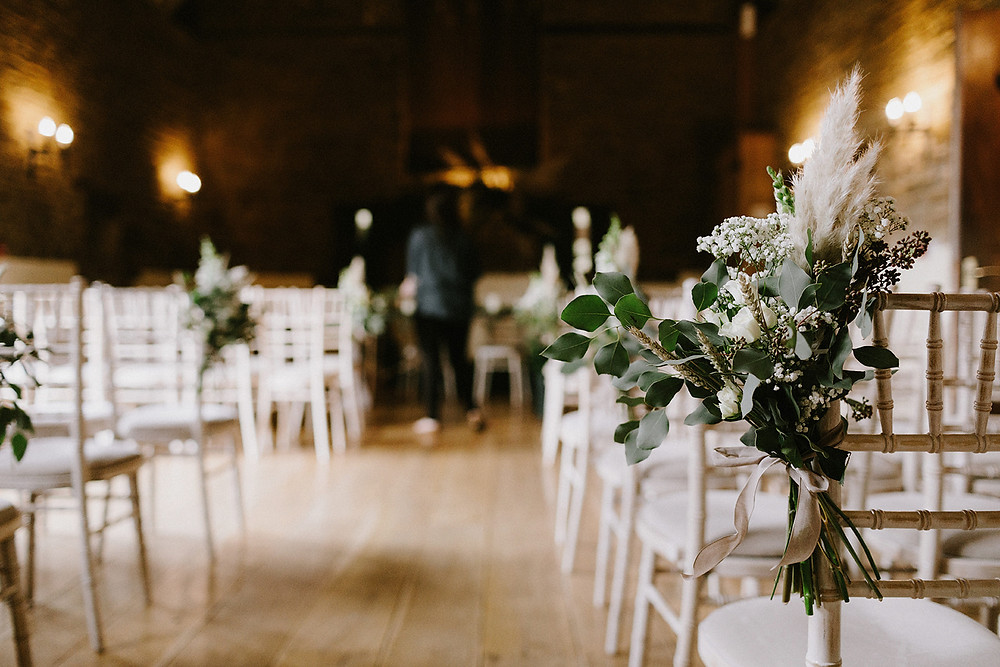 pampas grass floral pew ends at crockwell farm wedding venue