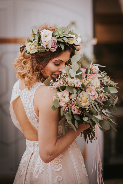 beautiful lace wedding dress and flower crown