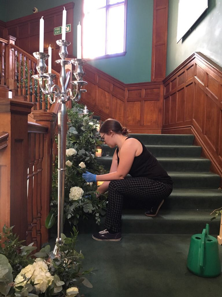 setting up a luxury floral staircase arrangement