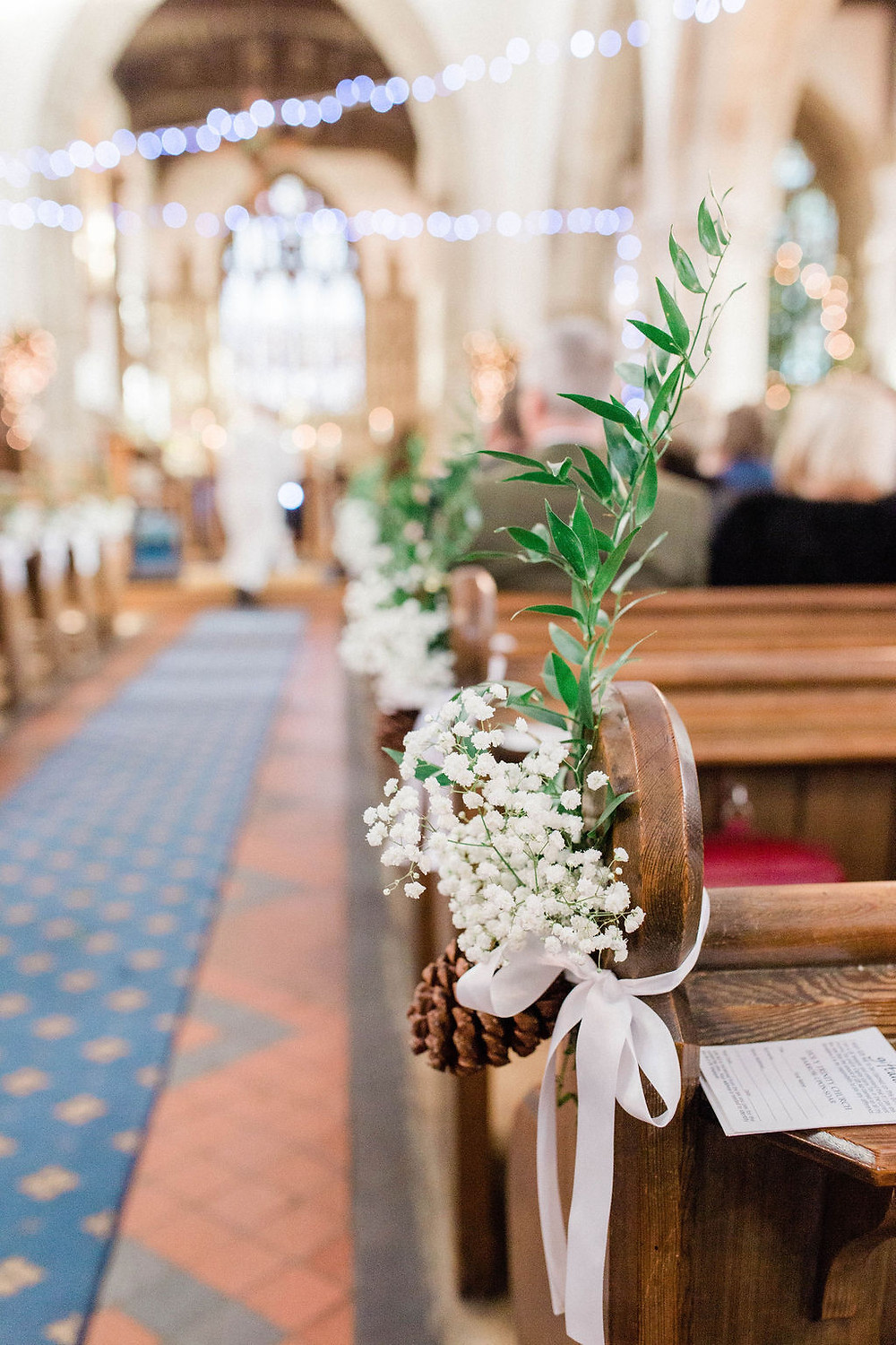 woodland wedding pew ends with pinecones