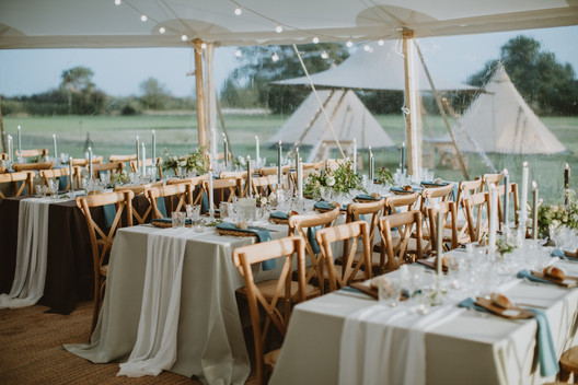 coloured grey wedding cloths with white table runners