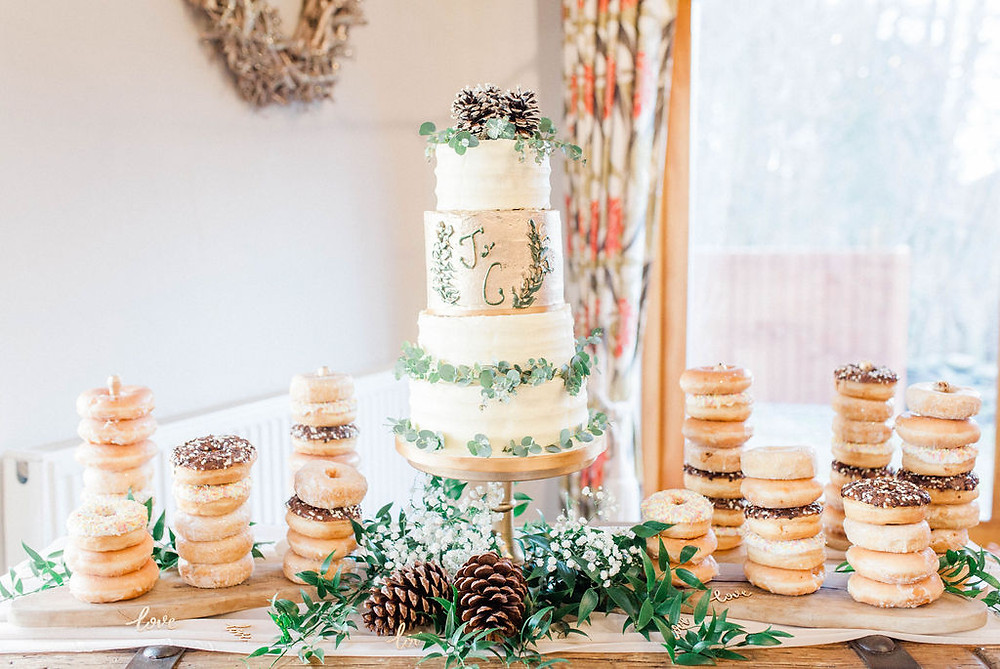 green, white and gold wedding cake
