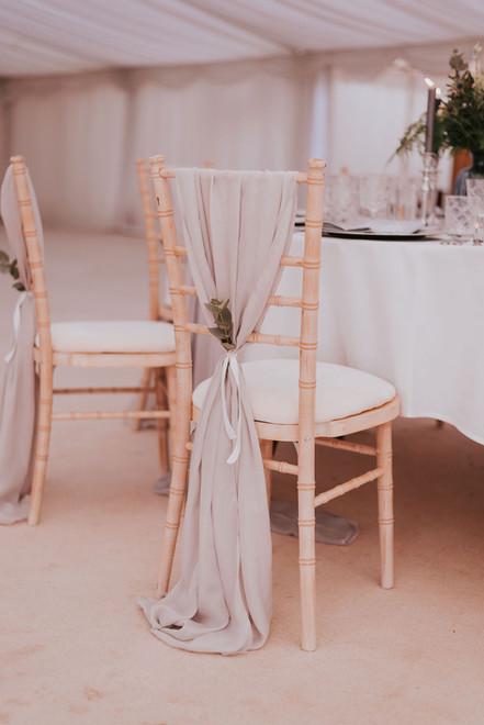 light grey chiffon chair drape and greenery
