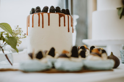 blackberry wedding cake with drippy sauce and fruit