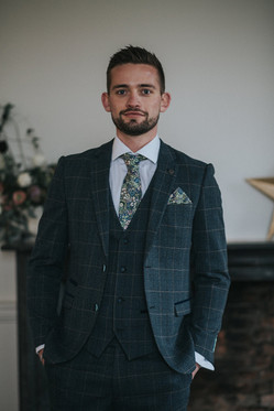 tweed suit with floral tie
