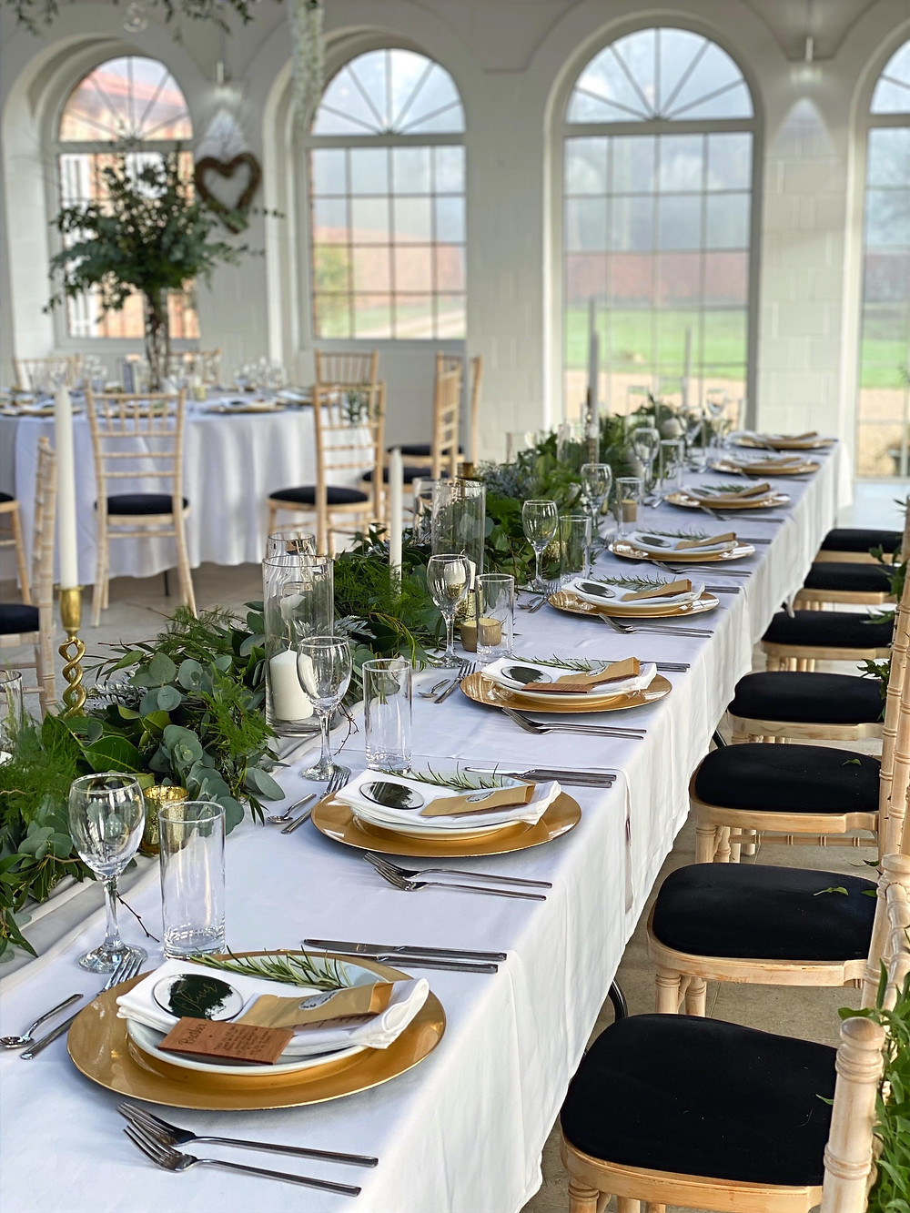 gold, green and white top table at irnham hall