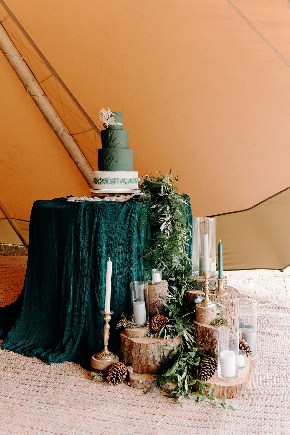forest themed cake display for wedding