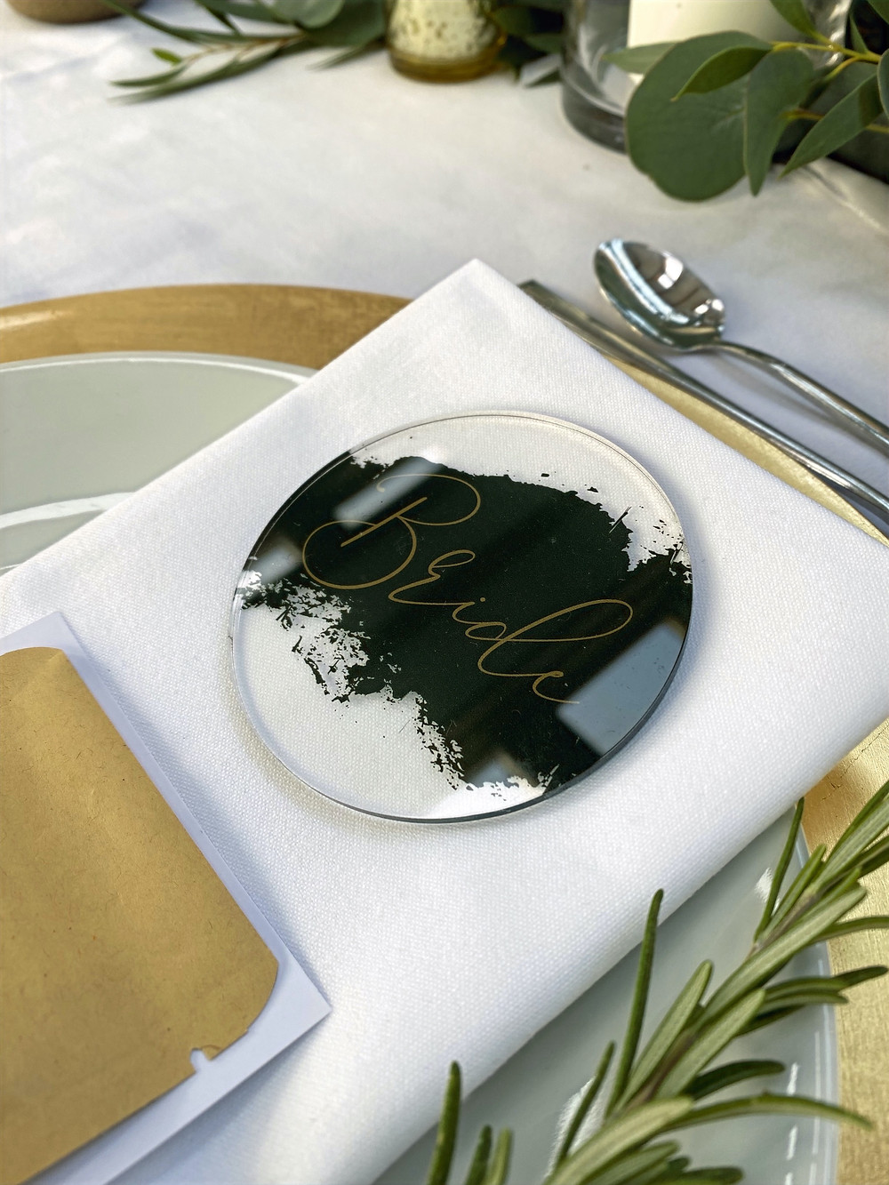 circle table names with green and gold writing