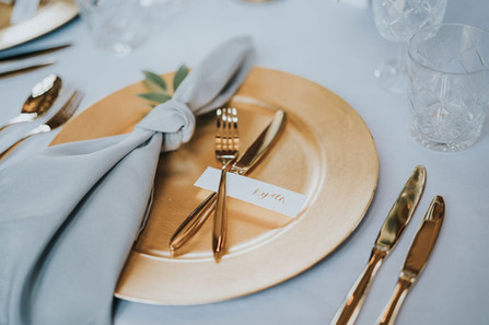 gold wedding day cutlery hire with grey fabric napkins