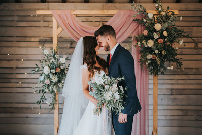 dustry pink wedding archway drapery with blush florals