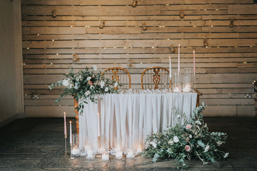drapery ceremony table with candles and florals