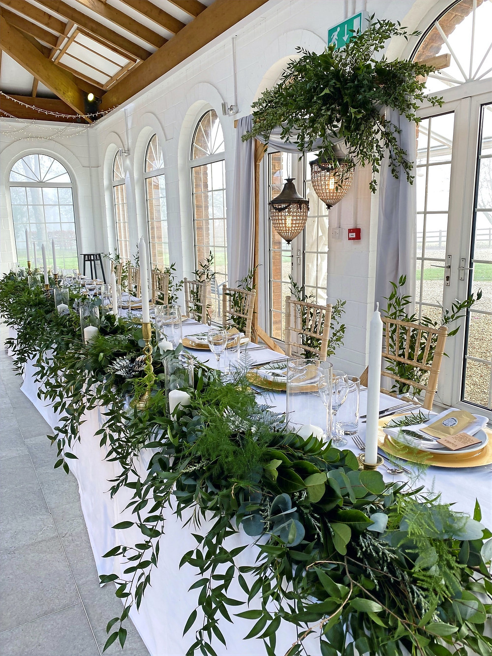 greenery top table garland with tall candles