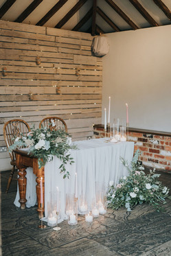 dodmoor house wedding ceremony room with grey registrar table and flowers