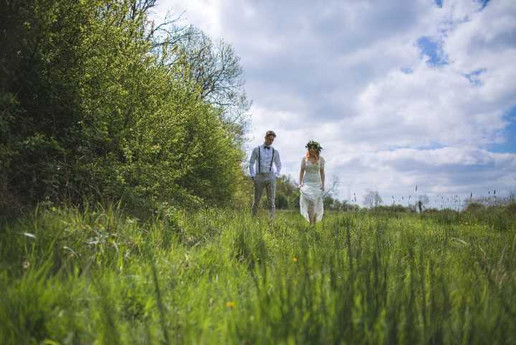 bride and groom in a meadow