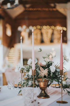 gold floral urn centrepieces with pink candles