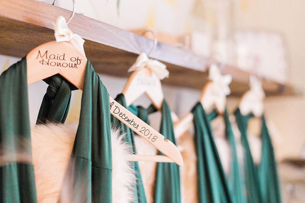 green bridesmaid dresses and coat hangers