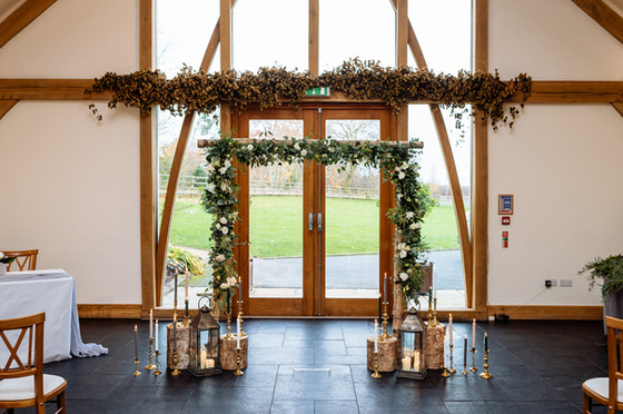 rustic wooden arch at mythe barn