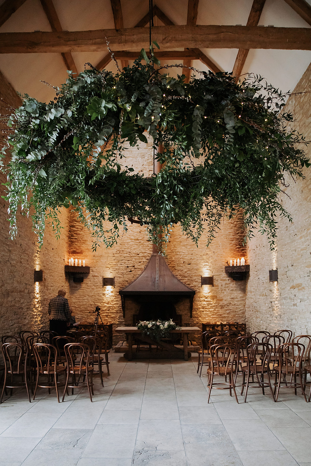 extra large hanging greenery hoop at stone barn cotswolds wedding