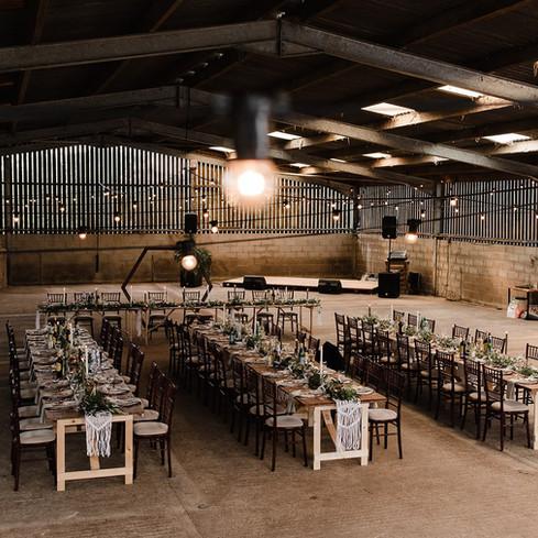 Barn wedding wooden long tables macrame
