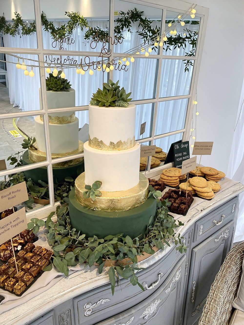 gold, white and green wedding cake
