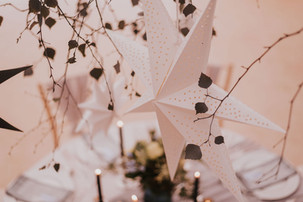 hanging stars ceiling decor at a marquee wedding