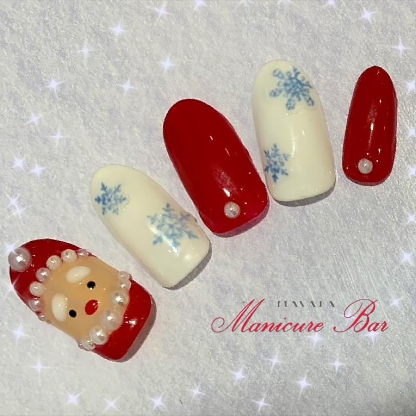 サンタクロースと白ベースに青色の雪の結晶