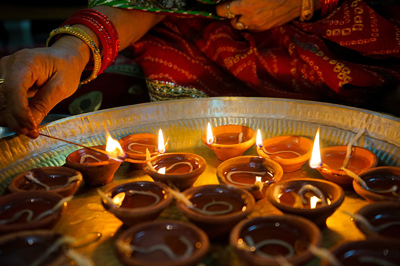 Diwali lamps being lit